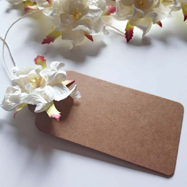 paper flower gift tag. Brown kraft tag with white gardenia