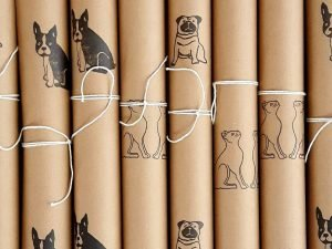 recyclable wrapping paper. Rolled sheets of wrapped by alice paper, with pugs, frenchies and cats.