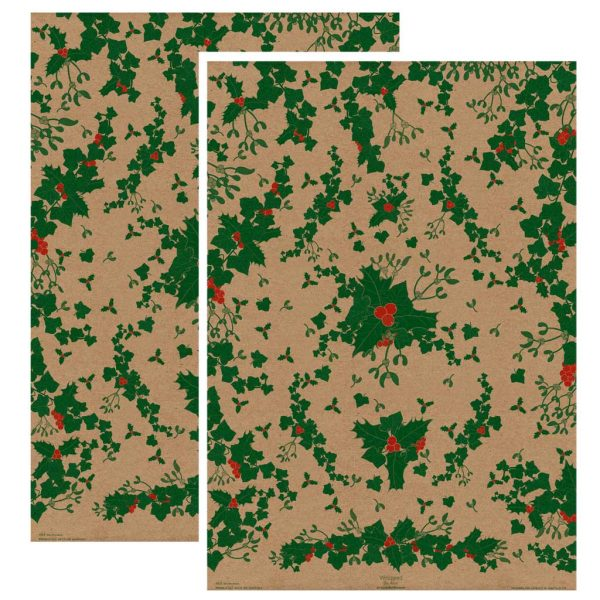 Two sheets of Christmas kraft wrapping paper with a print of holly, ivy and mistletoe