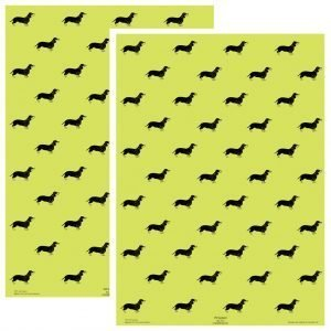 two sheets of pistachio green wrapping paper with a repeating pattern of black dachshunds