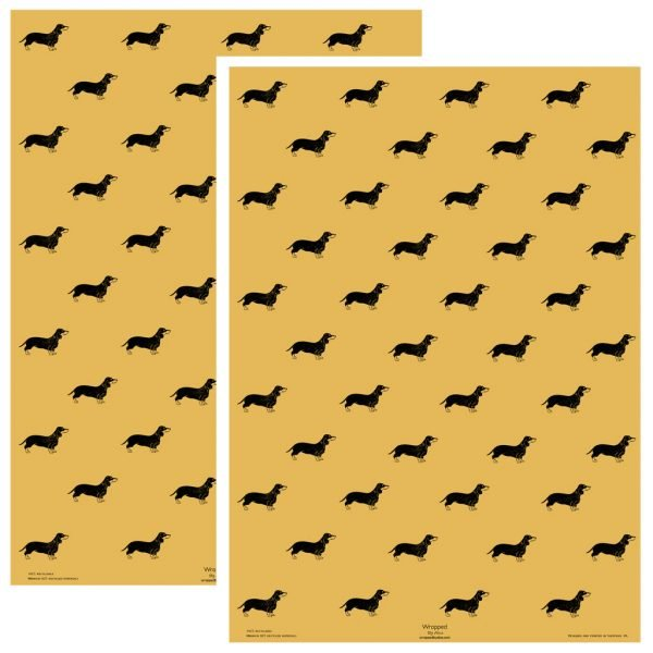 two sheets of sausage dog print yellow wrapping paper