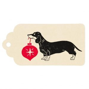 Dachshund christmas gift tag. Cream tag with dachshund holding red bauble