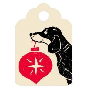 mini cream gift tag with dachshund holding red bauble