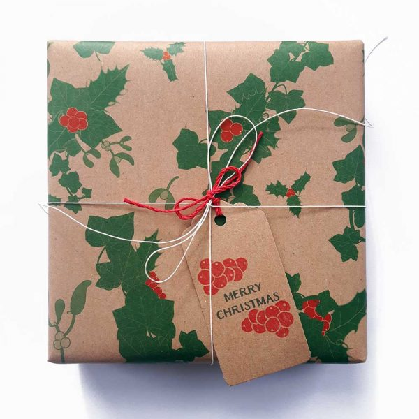 Gift wrapped in recycled brown kraft paper, with festive holly, ivy and mistletoe design