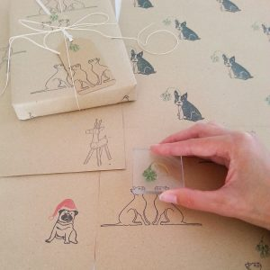 Hand printing christmas cat wrapping paper