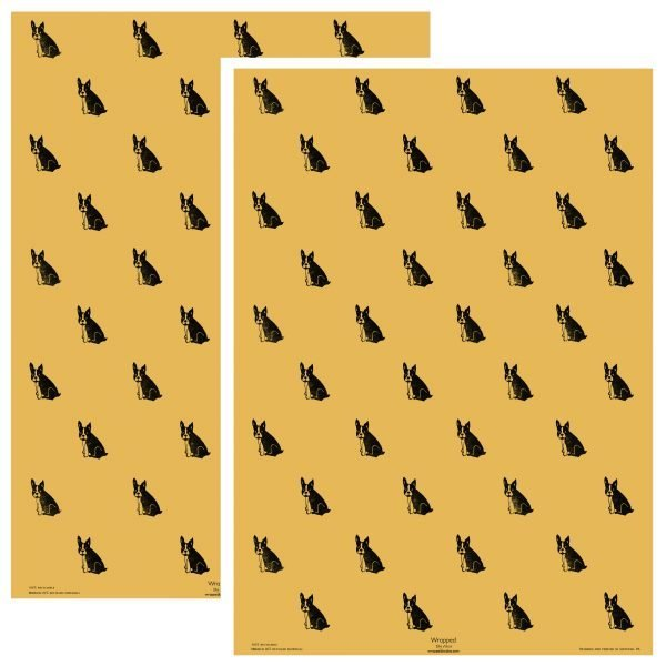 two sheets of yellow wrapping paper, with repeating pattern of black frenchies