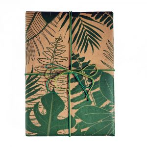 A gift wrapped in Wrapped By ALice tropical leaves paper, and tied with hemp cord from the Hemptique Emerald cord set.