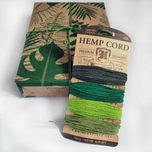 Hemptique Hemp Cord set - Emerald, next to a present wrapped in Wrapped By Alice paper and tied with cord from the set.