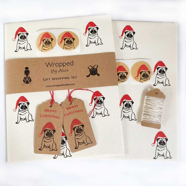 Christmas Pug gist wrap set - cream paper with black pugs wearing red santa hats, kraft stickers and gift tags and hemp cord.