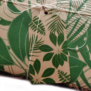 close up of tropical leaves gift tag on present