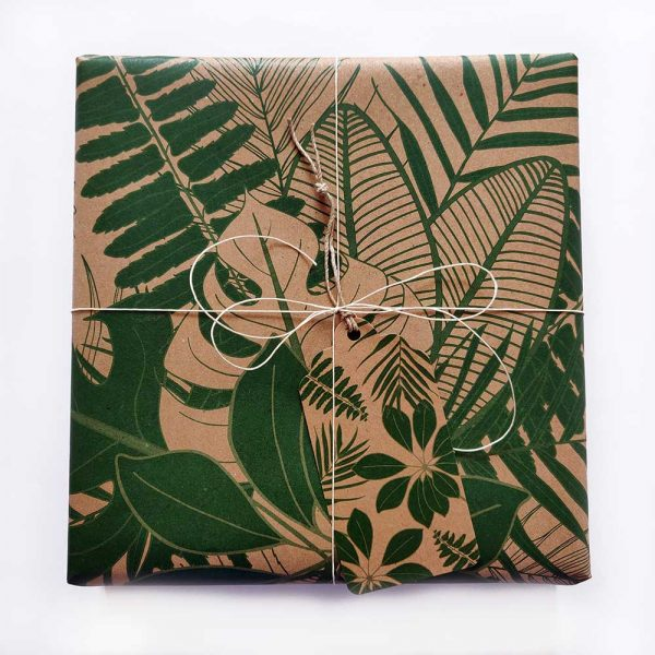 present wrapped with leaf wrapping paper, with tropical leaves gift tag