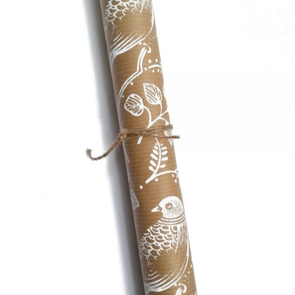 high res image of recycled wrapping paper roll with white turtle dove print