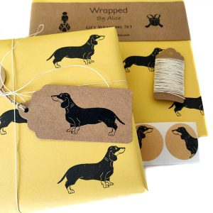 image shgowing contents of gift wrapping set - yellow dachshund