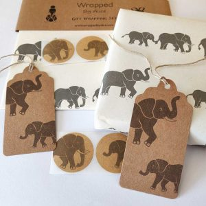 image showing contents of cream elephant gift wrap set - paper, tags and stickers