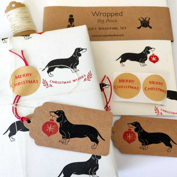 present wrapped with Christmas Dachshund gift wrapping set in cream