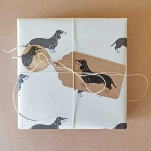 Gift, wrapped using the cream dachshund gift wrapping set.