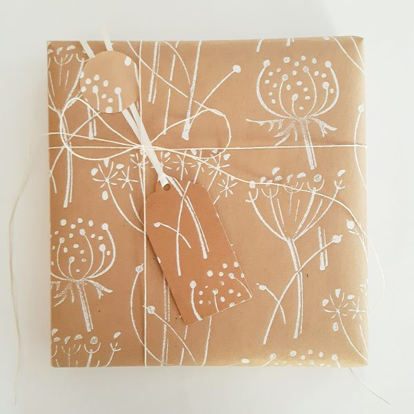present wrapped in white seed head wrapping paper