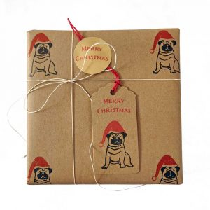 Present wrapped with brown kraft, Christmas pug wrapping paper, with matching tags and sticker.
