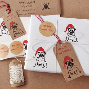 Present wrapped using cream, Christmas Pug gift wrap set from Wrapped By Alice.
