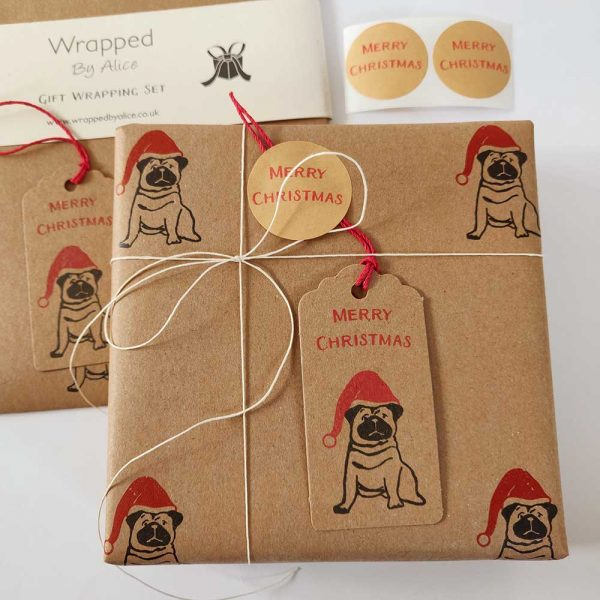present wrapped with Christmas Pug gift wrapping set.